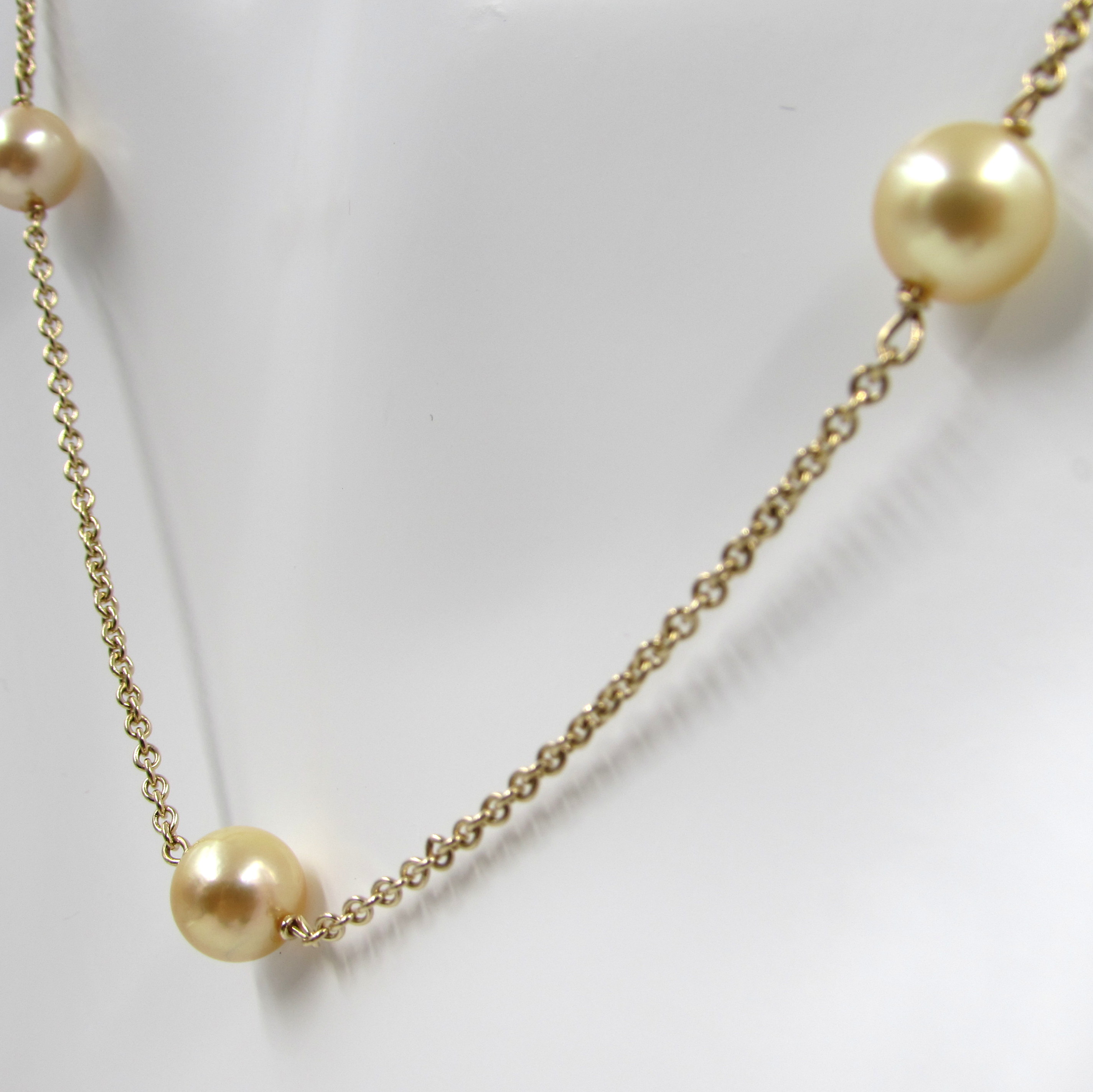new pearls baroque south sea golden strands and pin reflection